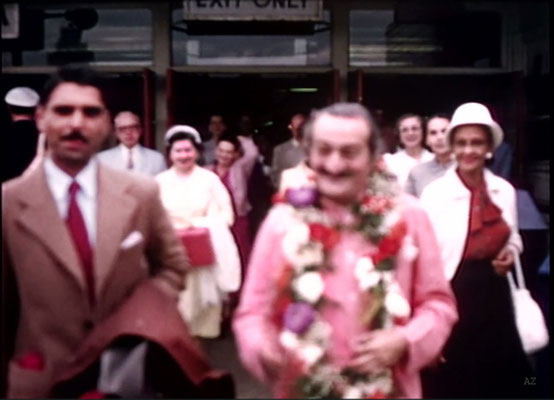 Idlewild Airport : Meher Baba greeted by his entourage outside the airport with Eruch Jessawala. Jean Shaw ( L ) look on.  Image captured by Anthony Zois from a film by Sufism Reoriented.