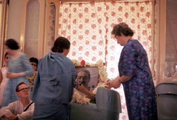 Mehera Irani & Ena Lemon garlanding Baba's photo. Courtesy of Larry & Rita Karrasch