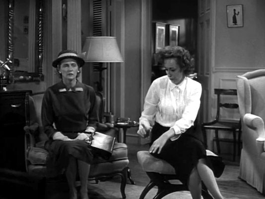 Joan ( left ) in the role of Miss Fern