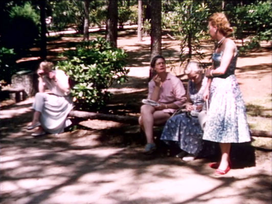 1956 ; Meher Center, Myrtle Beach, SC. ; Marion talking to Filis Frederick ( pink ). The images were captured by Anthony Zois from a film by Sufism Reoriented.