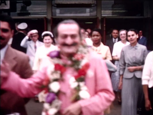 Idlewild Airport : Meher Baba greeted by his entourage outside the airport.Jean Shaw ( L ), Beryl Williams ( C ) & Ella Winterfeldt ( R ) look on.  Image captured by Anthony Zois from a film by Sufism Reoriented.