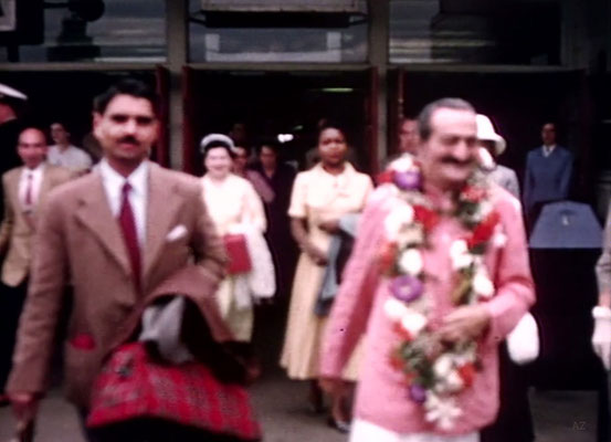 Idlewild Airport : Meher Baba greeted by his entourage outside the airport with Eruch Jessawala. Beryl Williams ( R ) & Jean Shaw ( L ) look on.  Image captured by Anthony Zois from a film by Sufism Reoriented.