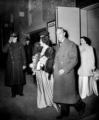 King George 6th, Queen Elizabeth and Princess Margaret arriving for a show at the theatre.