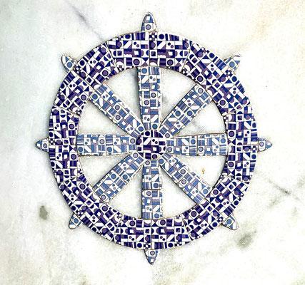 The Dharma Chakra or the Wheel represents the Buddhist faiths