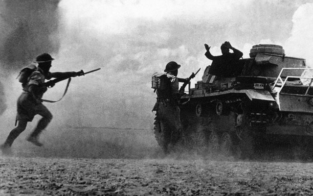 Allied troops capture an Axis tank