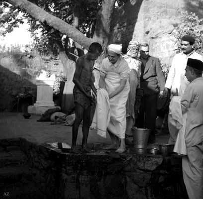 7th Nov.  Meher Baba washing a leper in the leper colony