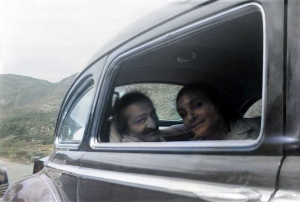 6th Aug. 1952. Baba with Mehera next to him showing her bandage on her forehead, on their way to Locarno from Zurich. Image colourized by Anthony Zois.