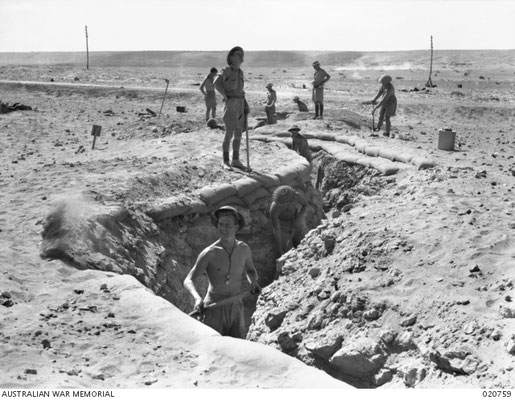 Allied troops digging trenches