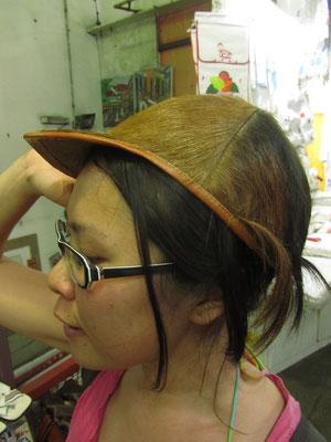 Ein Hut, oder ist es ein Kokosnussreiterhelm? (Mercado Modelo)