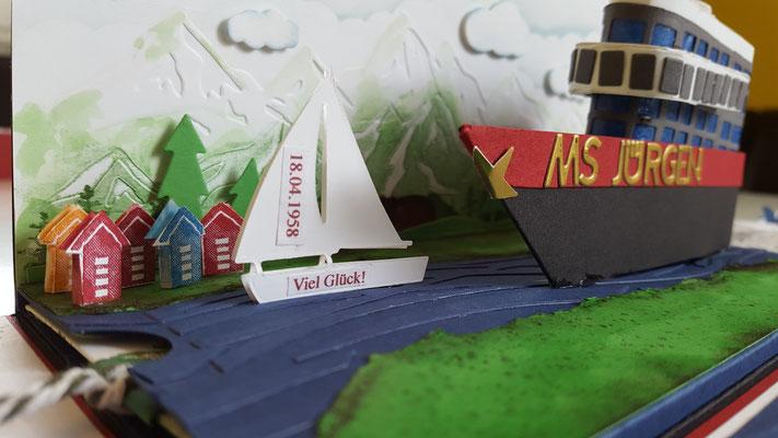 """Das kleine Schiff von """"Marina Sailboats"""" habe ich 2x ausgestanzt und mit doppelseitigem Abstandshaltern zusammen geklebt"""