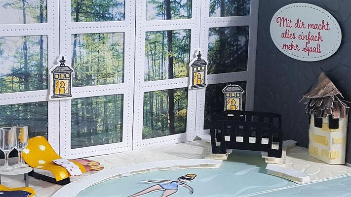 Hinter den Fenstern ist ein Foto aufgeklebt. Die Rahmen sind Stanzformen, die ich etwas zugeschnitten habe. Die Brück eine Eigenkreation