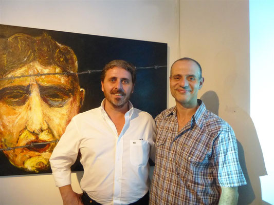 Nestor Favre Mossier y Walter Cohelo encargado del montaje de la muestra.