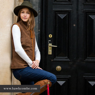 Brunette model in green hat and brown gillet, Social Media Graphics created by Design By Pie, Freelance graphic designer, North Devon