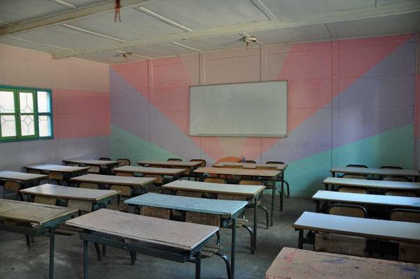 De eenvoudige klaslokalen van het schooltje 'école rural de Tighfert'