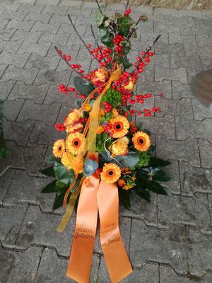 Trauergesteck orange Germini