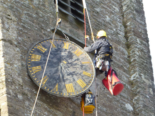 Arthur brings the clock face down to the ground