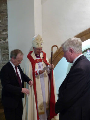 Alan Hughes (Whitechapel Bell Foundry) presents the rope to the Bishop (Photo: Nick Teage)