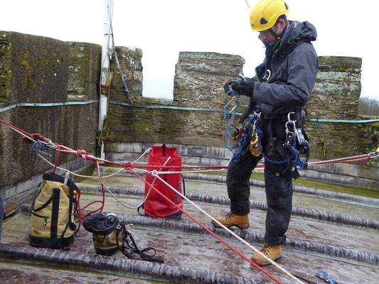 Arthur prepares to abseil down the tower