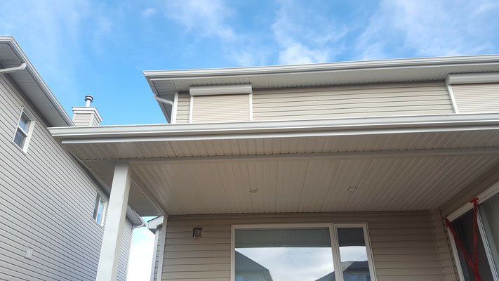 Covered deck roof addition eaves trough gutters downspouts