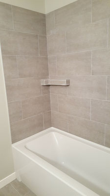Basement bathroom renovation tile tub surround