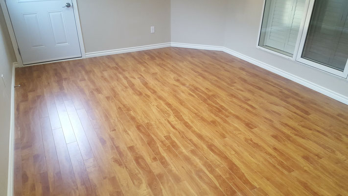 Three season room addition in-floor heated laminate flooring