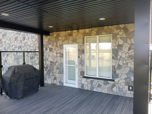 Covered deck addition cultured stone