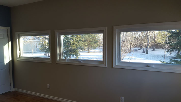 Three season room addition vinyl windows