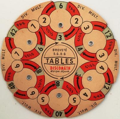 Anverso: Tables DISCOMATH multiplicación y división, dígitos 2 a 7, hecho en Francia, 12 cm diámetro