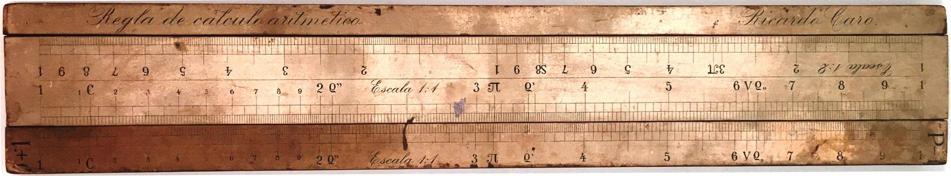 Regla de cálculo aritmético de RICARDO CARO Y ANCHÍA, escala 1:1 (números) frente a la escala 1:1 (números), año 1910, 45x8 cm