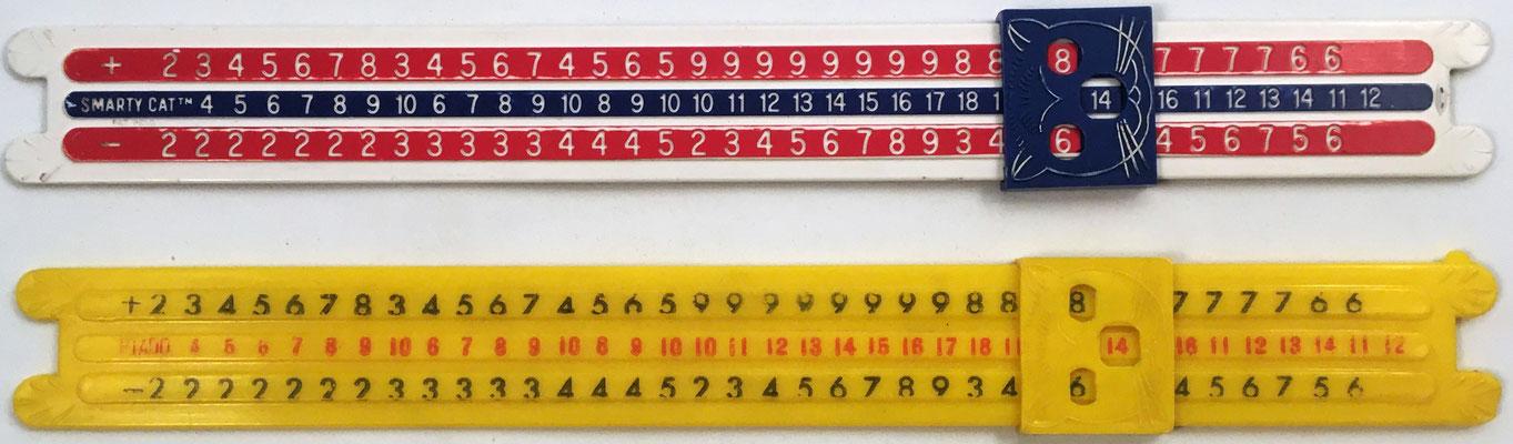 Dos versiones de la Regla de Cálculo Smarty Cat, operaciones de suma y resta, 28x3 cm