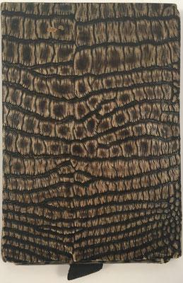 Ábaco de ranuras PRO CALCULO!, diseñado por Otto Meuter, dentro de su funda