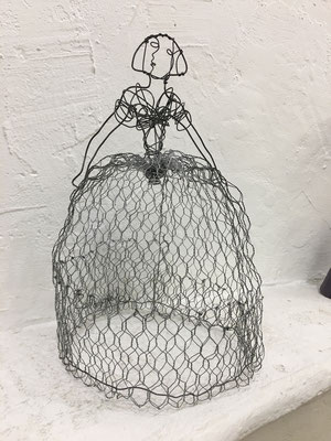 woman wire fence. Sold