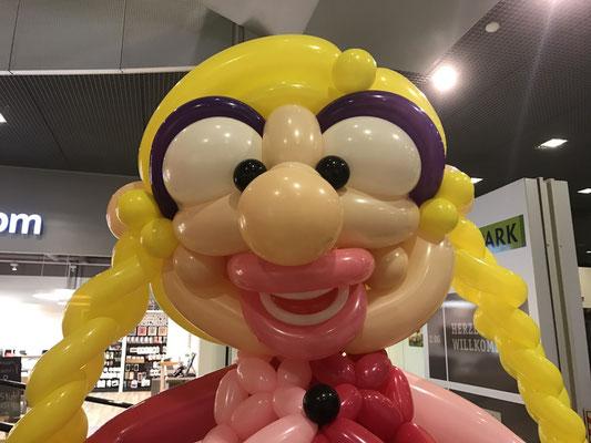 Ballonkopf Frau