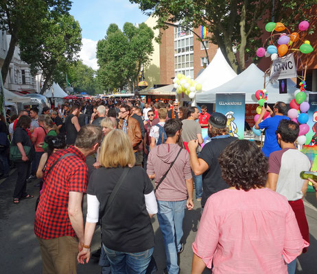 Visitors to Lesbian and Gay City Festival pass CO-WC booth
