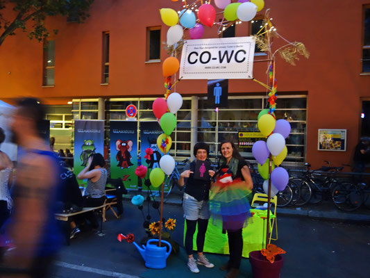People at Lesbian and Gay City Festival showing CO-WC sign