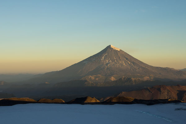 Volcan Lanin glowing in the late afternoon light of Chile's lake district.