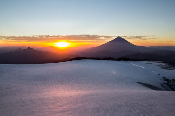 Sunrise over the summit crater of Volcan Quetrupillan in Chile's lake district.