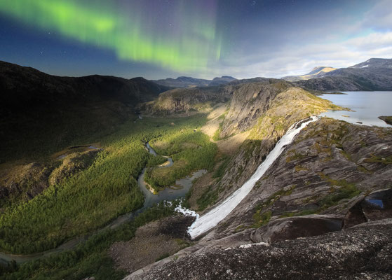 The magnificient Litlverivasfossen waterfall tumbles over 250 metres of bare rock in Rago national park, northern Norway. This photo blend combines evening light and the northern lights captured from one location.