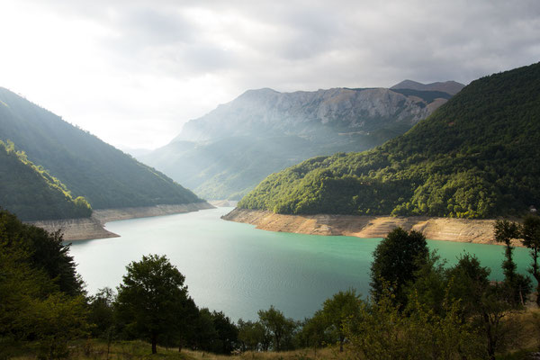 Sunlight bursting over Lake Piva, Montenegro