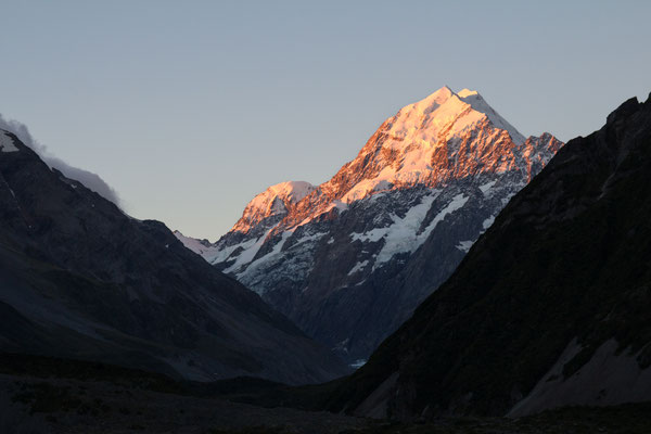 Aoraki/Mount Cook bathed in sunset hues, New Zealand.