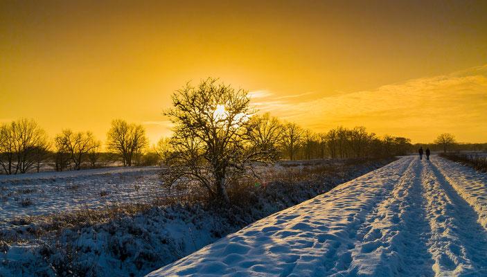 Winterlandschaft mit Sonnenuntergang