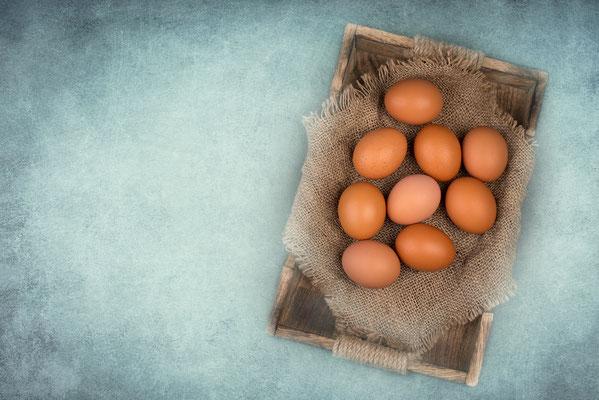 Eier auf einem blauen Hintergrund mit Textur