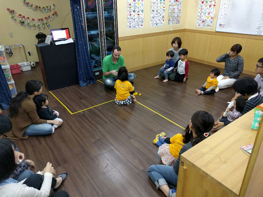 Saturday baby class, some of the babies older siblings are there to help