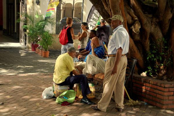 Schuhputzer auf der Plaza de Colon