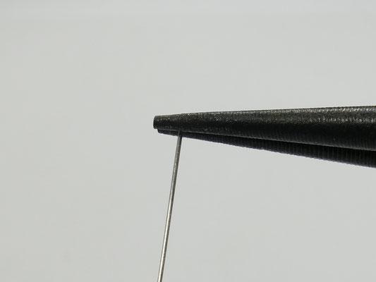 Position de la pince au bout du fil