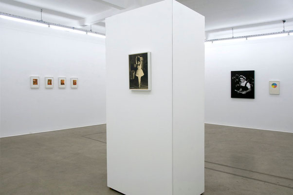 view of 'Subject: Free' (solo exhibition) center: 'The Performance' found photo, parquet, MDF, paint and sound system, 2010