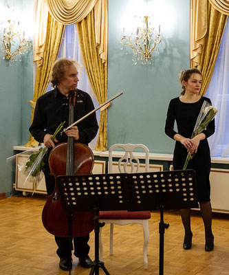 With cellist Dmitrii Khrychev