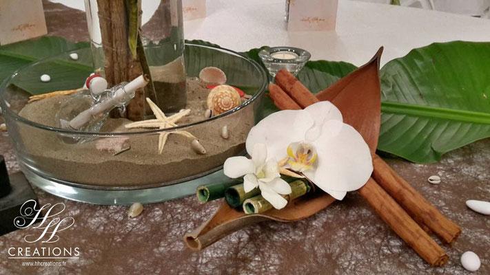 Décoration mariage coco orchidée sable