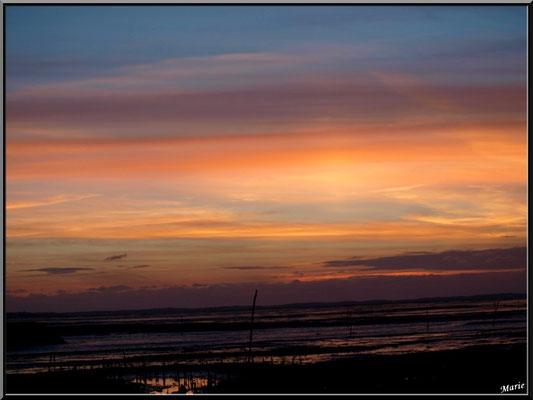 Coucher de soleil sur le Bassin, en juillet, vu du port