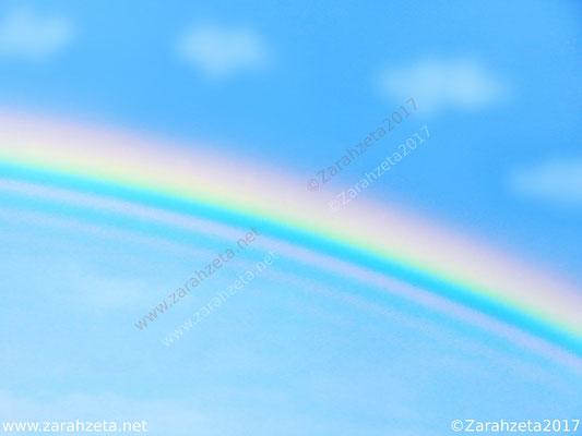 Regenbogen am blauen Himmel
